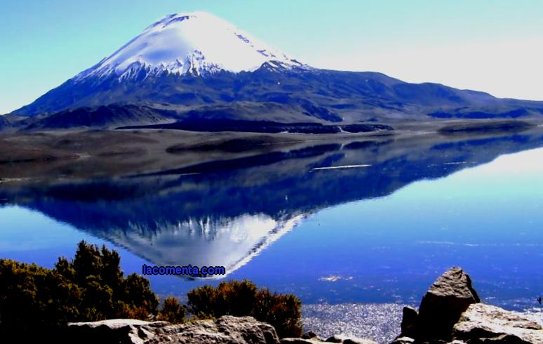 One of the highest mountain lakes on our planet is located in the Lauca National Park, in northern Chile, 9 km from the border with Bolivia. Lake Chungara, Chile is equated to one of the wonders of the world; this stunning place in a remote corner of the country beckons with its mysterious beauty and special high-mountain climate conditions. Tourists who have visited the lake note that it is there, at an altitude of 4517 m above sea level, that you can fully experience the greatness of the Chilean Andes.